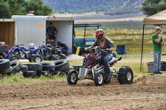 Woman starts four sheel ATV race rural track 1293.jpg - stock photo
