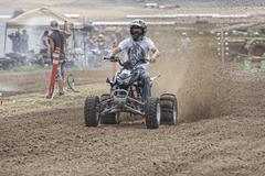 Modified powerful four wheel ATV races dirt track 1303.jpg - stock photo
