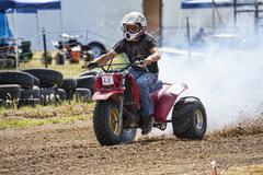 Racing three wheet ATV at rural race track 1318.jpg Stock Photos