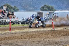 Man rides powerful ATV down dirt race track 1362.jpg - stock photo