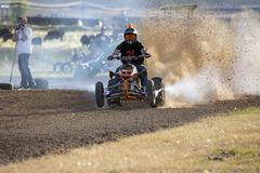 Man on powerful ATV races dirt flys 1388.jpg - stock photo