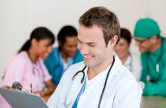 Young male Doctor Smiling at the camera Stock Photos