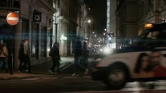 People walking down the street London Night  Police car Anamorphic flares Stock Footage