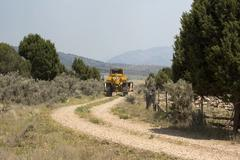 Caterpillar responds to forest wildfire central Utah 0600 - stock photo