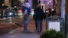 People walking down the street  street London Night Anamorphic flares 2 Stock Footage
