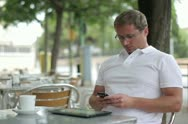 Stock Video Footage of Young handsome man using smartphone, outdoors NTSC