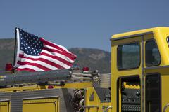 Fire truck USA flag at wildfire staging area 0646 - stock photo