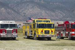 Fire trucks awaiting assignment to fight forest wildfire 0614 - stock photo