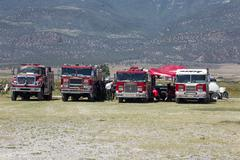 Fire trucks firefighter briefing for wildfire 0610 - stock photo