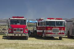 Fire trucks ready to deploy to forest wildfire 0643 - stock photo