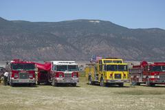 Fire trucks staged to deploy to forest wildfire 0613 - stock photo