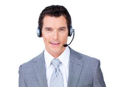 Self-assured businessman using headset - stock photo