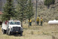 Firefighters and equipment plan to fight wildfire 0593 - stock photo