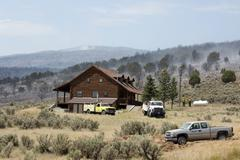 Forest wildfire firemen at threatened home 590 - stock photo