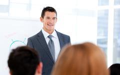 Self-assured businessman doing a presentation Stock Photos