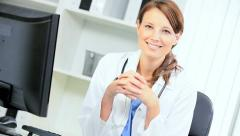 Female Consultant Updating Patient Records Stock Footage