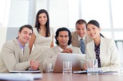 Stock Photo of Assertive business partners working at a computer