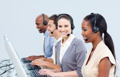 Assertive customer service representatives in a call-center Stock Photos