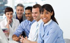 A diverse business group sitting in a line - stock photo