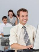 Stock Photo of Assertive businessman working at his computer