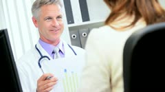 Doctor Meeting With Financial Advisor Stock Footage