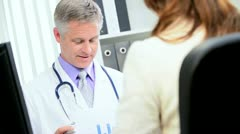 Male Doctor Meeting Pharmaceutical Representative Stock Footage