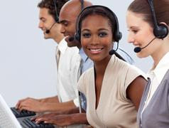 Business co-workers showing diversity in a call center - stock photo