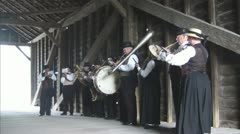 Old time Brass Band Performing Under Covered Bridge - stock footage