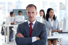 Confident manager leading his team in a call center - stock photo