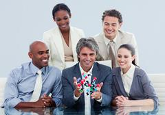 Animated business team showing a molecule - stock photo