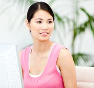 Stock Photo of Assertive businesswoman working at a computer