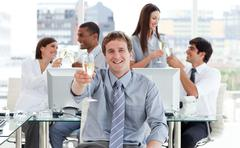 Animated business team drinking champagne - stock photo