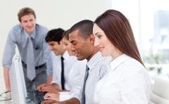 Multi-cultural business team at work Stock Photos