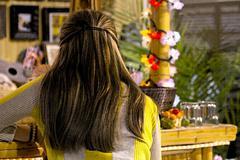 Beautiful woman at tropical bar artistic Stock Photos