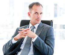 Self-assured businessman looking at the camera Stock Photos