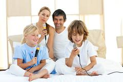 Animated family singing together - stock photo