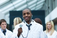 Doctor with his team in the background Stock Photos
