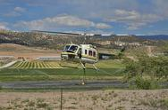 Fire fighting helicopter filling water bucket 0513.jpg Stock Photos