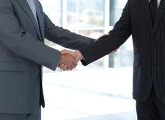 Handshake in agreement Stock Photos