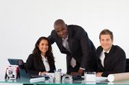 Stock Photo of Business team in an office smiling at the camera
