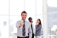 Business people celebrating a success with champagne - stock photo