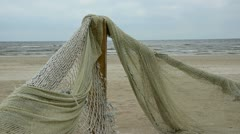 Old fishing nets on sea beach Stock Footage