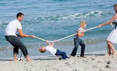 Animated family playing tug of war - stock photo
