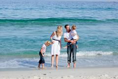 Animated family walking on the sand - stock photo