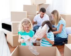 Animated family packing boxes Stock Photos
