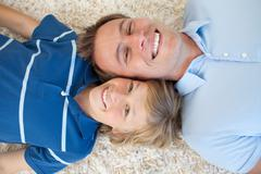 Animated father and his son lying on the floor Stock Photos