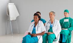 Medical team sitting at a conference Stock Photos