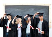 Group of teenagers celebrating after Graduation Stock Photos