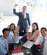Business people in a meeting celebrating a success - stock photo