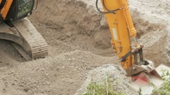 Excavating on construction site Stock Footage